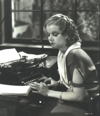 Jean_harlow_1932_red_head_typewriter